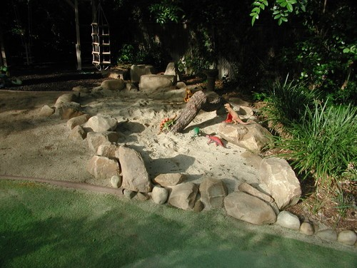 Bring the beach to your backyard by creating a sand pit. With buckets, shovels and other sand sidekicks, they can create to their hearts' content.