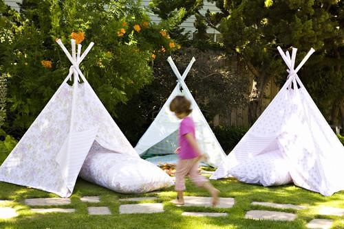 For cool shade during the day and starry slumber at night, try building forts and teepees. Since children love little hideaways and spaces they can call their own, miniature camps like these are sure to be a hit. Invite a few friends over, build a fire and roast marshmallows for a slumber party they will never forget.