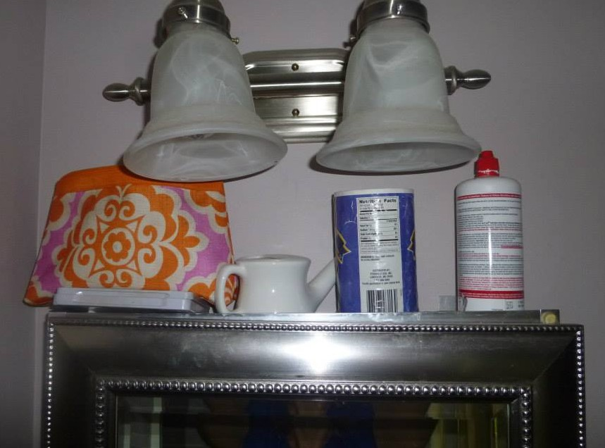 The clear valuables at the top--you know, make-up, neti-pot and the like...