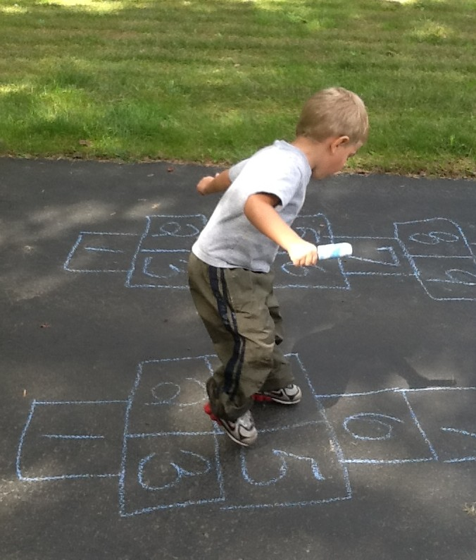 Son playing hopscotch as part of physical therapy @meredithspidel