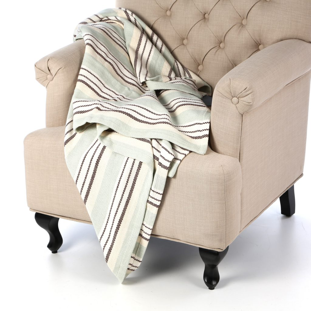 Looking for a soft touch of color to add to a chair or bed? This sweet woven cotton throw is a gentle accent.