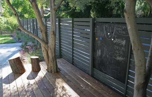 For endless hours of artsy fun, convert a section of your fence into a chalkboard. As a great weekend DIY project, follow these steps and you're set!