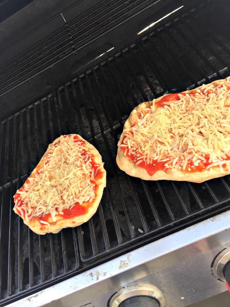 If you've never made homemade pizza this way, get ready to have your taste buds amazed! Grilled pizza is so yummy, so easy and a definite family-friendly crowd-pleaser food. Check this trick for making it work like a charm, and also grab this fun party food idea here--I love this one!