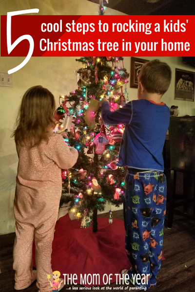 Putting up a kids' Christmas tree is one of the best holiday decorating traditions we have! Our whole family loves this special way to celebrate the Chrstmas season, and here are the smart tips you need to make it work in your home!