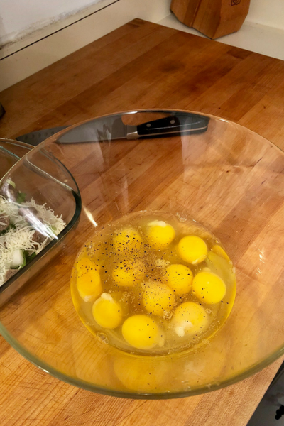 Sprinkle with .5 cups shredded cheese. Beat the eggs with the salt and pepper and pour on top. Top with remaining cheese.