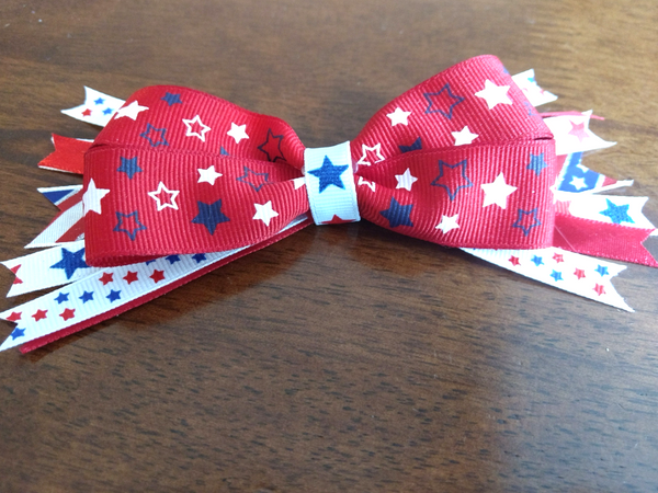 DIY Patriotic Bows are the PERFECT way to get your little gal in the Americana spirit for Memorial Day or July 4th! You'll be surprised at how easy these are to whip up! Save a ton of money making your own vs. purchasing store-bought, and these make a super gift too! And MAKE SURE to catch the smart tips at the end about what mistakes to avoid for better results!